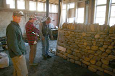 Dry stone wall test being examined